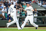Kyle Seager #15 (R) celebrates with Nelson Cruz #23 of the Seattle Mariners after hitting a three run home run against the Los Angeles Dodgers in the first inning during their game at Safeco Field on August 18, 2018 in Seattle, Washington.