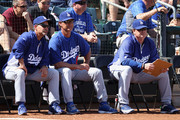 (L-R) Bench coach Trey Hillman, manager Don Mattingly and pitching coach Rick Honeycutt of the Los Angeles Dodgers watch from the bench during the spring training game against the Texas Rangers at Surprise Stadium on March 9, 2012 in Surprise, Arizona.