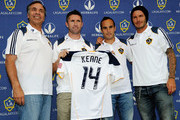 Newly acquired Los Angeles Galaxy forward Robbie Keane#14 holds his jersey as he poses with teammates David Beckham #23, Landon Donovan #10 and head coach Bruce Arena (R) after a news conference at The Home Depot Center on August 19, 2011 in Carson, California. Keane, who is the captain of Ireland's national team, will make his MLS debut against the San Jose Earthquakes on Saturday at The Home Depot Center.
