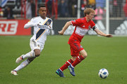 Dax McCarty #6 of the Chicago Fire controls the ball in front of Ola Kamara #11 of the Los Angeles Galaxy. at Toyota Park on April 14, 2018 in Bridgeview, Illinois. The Galaxy defeated the Fire 1-0.