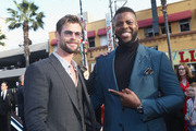 Actors Chris Hemsworth (L) and Winston Duke attend the Los Angeles Global Premiere for Marvel Studios' Avengers: Infinity War on April 23, 2018 in Hollywood, California.