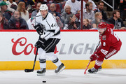 Robyn Regehr #44 of the Los Angeles Kings skates with the puck ahead of Tobias Rieder #8 of the Arizona Coyotes during the NHL game at Gila River Arena on December 4, 2014 in Glendale, Arizona.  The Kings defeated the Coyotes 4-0.