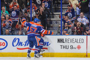 David Perron #57 (L) and Taylor Hall #4 of the Edmonton Oilers celebrate after Hall scored the team's first goal against the Los Angeles Kings during an NHL game at Rexall Place on March 09, 2014 in Edmonton, Alberta, Canada.
