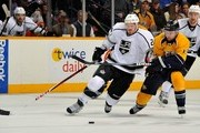 Colin Fraser #24 of the Los Angeles Kings skates against Nick Spaling #13 of the Nashville Predators at the Bridgestone Arena on February 7, 2013 in Nashville, Tennessee.