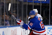 Rick Nash #61 of the New York Rangers and Robyn Regehr #44 of the Los Angeles Kings fight for the puck in the second period on March 24, 2015 at Madison Square Garden in New York City.