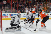 Jonathan Quick #32 and Drew Doughty #8 of the Los Angeles Kings defend against Pierre-Edouard Bellemare #78 of the Philadelphia Flyers at the Wells Fargo Center on November 17, 2015 in Philadelphia, Pennsylvania. The Kings defeated the Flyers 3-2 in the shootout.