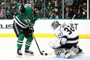 Jonathan Quick #32 of the Los Angeles Kings makes the save against Jamie Benn #14 of the Dallas Stars in the third period at American Airlines Center on October 23, 2018 in Dallas, Texas.