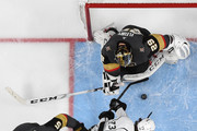 Marc-Andre Fleury #29 of the Vegas Golden Knights blocks a shot by Tyler Toffoli #73 of the Los Angeles Kings as Deryk Engelland #5 and Shea Theodore #27 of the Golden Knights defend in the first overtime period of Game Two of the Western Conference First Round at T-Mobile Arena on April 13, 2018 in Las Vegas, Nevada. The Golden Knights won 2-1 in double overtime.