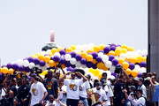 (Top-Bottom, L-R): Pau Gasol, Kobe Bryant, Shannon Brown, Derek Fisher, Lamar Odom, DJ Mbenga, Luke Walton, Sasha Vujacic, Adam Morrison, Sun Yue, Trevor Ariza and Jordan Farmar of the Los Angeles Lakers walk down the steps during the 2009 NBA Championship Victory Parade at the Los Angeles Memorial Coliseum on June 17, 2009 in Los Angeles, California.