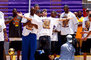 (L-R) Kobe Bryant, Lamar Odom, Pau Gasol, Sasha Vujacic, Luke Walton (C), Trevor Ariza and DJ Mbenga of the Los Angeles Lakers celebrate on stage during the 2009 NBA Championship Victory Parade at the Los Angeles Memorial Coliseum on June 17, 2009 in Los Angeles, California.