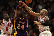 Carlos Boozer #5 of the Chicago Bulls knocks the ball away from Kobe Bryant #24 of the Los Angeles Lakers as Loul Deng #9 also defends at the United Center on December 10, 2010 in Chicago, Illinois. The Bulls defeated the Lakers 88-84..NOTE TO USER: User expressly acknowledges and agrees that, by downloading and/or using this photograph, User is consenting to the terms and conditions of the Getty Images License Agreement.