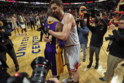 Pau Gasol #16 of the Chicago Bulls hugs Kobe Bryant #24 of the Los Angeles Lakers after a game at the United Center on February 21, 2016 in Chicago, Illinois. The Bulls defeated the Lakers 126-115. NOTE TO USER: User expressly acknowledges and agrees that, by downloading and or using the photograph, User is consenting to the terms and conditions of the Getty Images License Agreement.