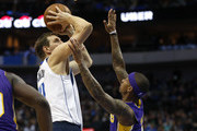 Dirk Nowitzki #41 of the Dallas Mavericks shoots over Isaiah Thomas #7 of the Los Angeles Lakers in the second half at American Airlines Center on February 10, 2018 in Dallas, Texas. The Mavericks won 130-123.