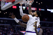 Anthony Davis #3 of the Los Angeles Lakers dunks in front of Montrezl Harrell #5 of the LA Clippers during a 112-103 Lakers win at Staples Center on March 08, 2020 in Los Angeles, California.   NOTE TO USER: User expressly acknowledges and agrees that, by downloading and or using this photograph, User is consenting to the terms and conditions of the Getty Images License Agreement.