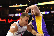 Blake Griffin #32 of the Los Angeles Clippers drives on Ryan Kelly #4 of the Los Angeles Lakers during a 105-100 Laker win at Staples Center on April 7, 2015 in Los Angeles, California.  NOTE TO USER: User expressly acknowledges and agrees that, by downloading and or using this Photograph, user is consenting to the terms and condition of the Getty Images License Agreement.