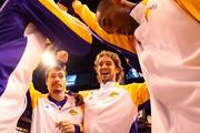 (L-R) Adam Morrison #6, Pau Gasol #16 and Kobe Bryant #24 of the Los Angeles Lakers huddle up before the NBA game against the Phoenix Suns at US Airways Center on December 28, 2009 in Phoenix, Arizona. The Suns defeated the Lakers 118-103. NOTE TO USER: User expressly acknowledges and agrees that, by downloading and or using this photograph, User is consenting to the terms and conditions of the Getty Images License Agreement.
