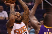 P.J. Tucker #17 of the Phoenix Suns attempts a shot over Luol Deng #9 of the Los Angeles Lakers during the second half of the NBA game at Talking Stick Resort Arena on February 15, 2017 in Phoenix, Arizona. The Pelicans defeated the Suns 110-108. NOTE TO USER: User expressly acknowledges and agrees that, by downloading and or using this photograph, User is consenting to the terms and conditions of the Getty Images License Agreement.