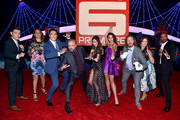 "(L-R) Actors Ryan Potter, Maya Rudolph, Daniel Henney, Daniel Adsit, Jamie Chung, Genesis Rodriguez, T.J. Miller, Katie Lowes and Damon Wayans Jr. attend the Los Angeles Premiere of Walt Disney Animation StudiosÂ' Â""Big Hero 6' at El Capitan Theatre on November 4, 2014 in Hollywood, California."