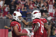 Wide receiver Larry Fitzgerald #11 of the Arizona Cardinals reacts with teammates wide receiver Jaron Brown #13 and tight end Ricky Seals-Jones #86 after scoring a second quarter touchdown during the NFL game against the Los Angeles Rams at the University of Phoenix Stadium on December 3, 2017 in Glendale, Arizona.