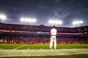 Los Angeles Rams head coach Jeff Fisher watches from the sideline when they officials delayed the final two minutes of their game against the Tampa Bay Buccaneers because of a weather delay during their NFL football game  at Raymond James Stadium on September 25, 2016 in Tampa, Florida.