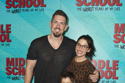 """Actors Steve Howey (L), Sarah Shahi and their son attend  the Los Angeles Red Carpet Screening of """"Middle School"""" in Hollywood, California, on October 5, 2016. / AFP / VALERIE MACON"""