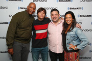 (L-R) Stanley T. , singer Louis Tomlinson, Ryan Sampson and Nicole Ryan pose for photos during a taping of SiriusXM Hits 1 at SiriusXM Studios on October 24, 2019 in New York City.