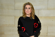 Catherine Deneuve attends the Louis Vuitton show as part of the Paris Fashion Week Womenswear Spring/Summer 2019 on October 2, 2018 in Paris, France.