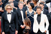 """Designer Peter Dundas (L), Evangelo Bousis (R) and Model Emily Ratajkowski attend the """"Loveless (Nelyubov)"""" screening during the 70th annual Cannes Film Festival at Palais des Festivals on May 18, 2017 in Cannes, France."""