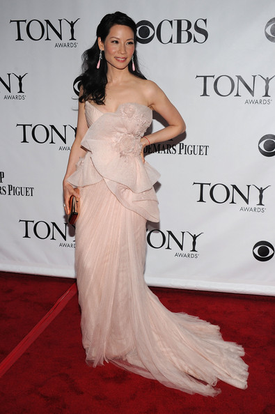 64th Annual Tony Awards - Arrivals [gown,dress,clothing,shoulder,fashion model,carpet,red carpet,hairstyle,strapless dress,lady,arrivals,lucy liu,tony awards,new york city,radio city music hall,64th annual tony awards]
