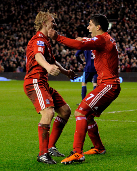 Luis Suarez Luis Suarez of Liverpool celebrates with team mate Dirk Kuyt (L) after Andy Wilkinson of Stoke City scored an own goal during the Barclays Premier League match between Liverpool and Stoke City at Anfield on February 2, 2011 in Liverpool, England.