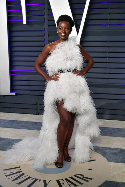 2019 Vanity Fair Oscar Party Hosted By Radhika Jones - Arrivals [oscar party,vanity fair,white,fashion,clothing,fur,haute couture,dress,feather,shoulder,fashion design,fashion show,beverly hills,california,wallis annenberg center for the performing arts,radhika jones - arrivals,radhika jones,lupita nyongo]