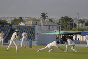 John Simpson (2R) looks at Paul Collingwood (3R) of MCC as he drops Aron Nijjar (3L) of Essex during Day Three of the MCC Champion County Match, MCC v ESSEX on March 29, 2018 in Bridgetown, Barbados.