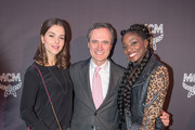 Susan Hoecke wearing 'Milla Clutch', MCM CEO Paolo Fontanelli and Nikeata Thompson wearing 'Diamond Disco' bag (L-R) attend the MCM Space Odyssey Event at Frankfurt Opera Store on October 22, 2015 in Frankfurt am Main, Germany.