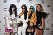 (L-R) Sita Abellan, Misa Hylton, Talia Coles and Anna Dello Russo attend the MCM Fashion Show Spring/Summer 2019 during the 94th Pitti Immagine Uomo on June 13, 2018 in Florence, Italy.