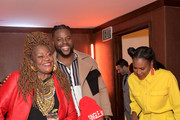 Cora Pantin, Winston Duke, King Bach and Sydelle Noel attend MCM x GQ Celebrate 2018 Breakout Star Winston Duke The Restaurant at Montage Beverly Hills on December 19, 2018 in Beverly Hills, California.