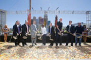 (L-R) Golden Boy Promotions CEO Richard Schaefer, Clark County Commissioner Steve Sisolak, MGM Resorts International Chairman and CEO Jim Murren, WBC welterweight champion Floyd Mayweather Jr., President and CEO of AEG Dan Beckerman, sportscaster Bill Walton, President of business operations for the Los Angeles Kings Luc Robitaille and UFC President Dana White shovel dirt during a groundbreaking for a USD 375 million, 20,000-seat sports and entertainment arena being built by MGM Resorts International and AEG on May 1, 2014 in Las Vegas, Nevada. The arena is scheduled to open in early 2016.