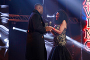 Founder of MOBO, Kanya King (R) presents Idris Elba with the Paving The Way award at the MOBO Awards at First Direct Arena Leeds on November 29, 2017 in Leeds, England.