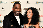 Idris Elba (L) and founder of MOBO, Kanya King pose in the winners room with the Paving The Way award at the MOBO Awards at First Direct Arena Leeds on November 29, 2017 in Leeds, England.