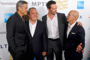"""(L-R)  Host George Clooney, event chair Jim Gianopulos, actor Hugh Jackman, and producer Jeffrey Katzenberg attend the MPTF 95th anniversary celebration with """"Hollywood's Night Under The Stars"""" at MPTF Wasserman Campus on October 1, 2016 in Los Angeles, California."""
