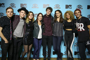 (L-R) Guitarist Jamie Sierota of Echosmith, drummer Graham Sierota of Echosmith,  vocalist Sydney Sierota of Echosmith, MTV executive Amy Doyle, bassist Noah Sierota of Echosmith, MTV executive Joanna Bomberg, singer Tori Kelly and rapper Jake Miller pose backstage at MTV Artist to Watch kickoff event at House of Blues Sunset Strip on January 23, 2014 in West Hollywood, California.