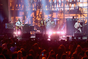 Matthew Followill, Caleb Followill, Nathan Followill and Jared Followill of King of Leon perform on stage at the MTV Europe Music Awards 2016 on November 6, 2016 in Rotterdam, Netherlands.