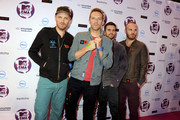 (L-R) Jonny Buckland, Chris Martin, Guy Berryman and Will Champion of Coldplay attend the MTV Europe Music Awards 2011 at the Odyssey Arena on November 6, 2011 in Belfast, Northern Ireland.