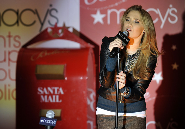 Emily Osment performs at the Christmas Window Unveiling Spectacular at Macy's Herald Square on November 19, 2009 in New York City.
