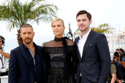 "(L-R)  Tom Hardy, Charlize Theron and Nicholas Hoult attend a photocall for ""Mad Max: Fury Road"" during the 68th annual Cannes Film Festival on May 14, 2015 in Cannes, France."