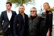 "(L-R) Nicholas Hoult, Tom Hardy, George Miller and Charlize Theron attend a photocall for ""Mad Max: Fury Road"" during the 68th annual Cannes Film Festival on May 14, 2015 in Cannes, France."