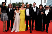"(L-R) Actress Courtney Eaton, producer Doug Mitchell, actors Zoe Kravitz, Charlize Theron, Tom Hardy, Nicholas Hoult, Margaret Sixel and director George Miller attend Premiere of ""Mad Max: Fury Road"" during the 68th annual Cannes Film Festival on May 14, 2015 in Cannes, France."