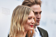 """Mia Wasikowska and Robert Pattinson attend the premiere of Magnolia Pictures' """"Damsel"""" at ArcLight Hollywood on June 13, 2018 in Hollywood, California."""