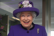 Queen Elizabeth II (L) smiles after cutting the cake during a visit to the International Maritime Organization (IMO) to mark the 70th anniversary of its formation on March 6, 2018 in London, England.