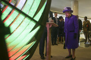 Queen Elizabeth II looks at an optic from the decommissioned Orfordness Lighthouse built by Chance Brothers of Smethwick and installed in Suffolk in 1913, during a visit to the International Maritime Organization (IMO) to mark the 70th anniversary of its formation on March 6, 2018 in London, England.