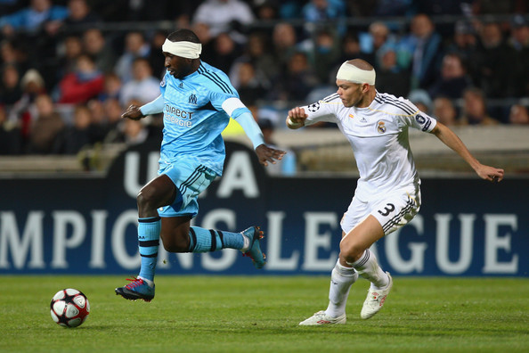 Marseille v Real Madrid - UEFA Champions League [player,sports,sports equipment,soccer,team sport,ball game,football player,sport venue,soccer player,football,mamadou niang,pepe,r,ball,stade velodrome,real madrid,marseille,uefa champions league,l,uefa champions league group c]